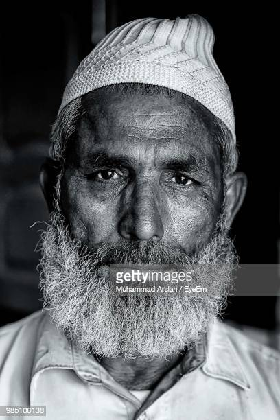Close-Up Portrait Of Man Wearing Taqiyah