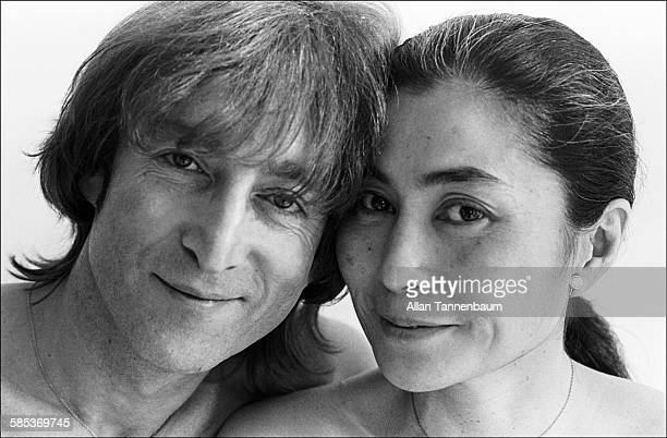 Closeup portrait of married musicians John Lennon and Yoko Ono in a SoHo gallery New York New York November 26 1980 The gallery was one of several...