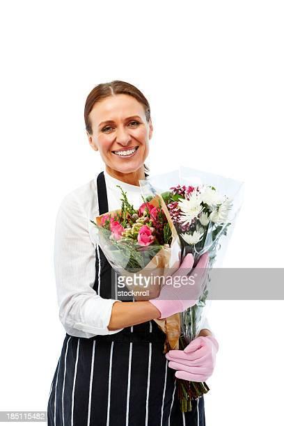 Closeup portrait of mature florist holding bouquet