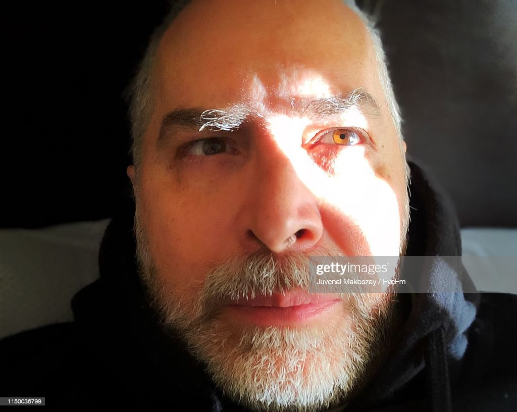 Close-Up Portrait Of Mature Man At Home : Stock Photo