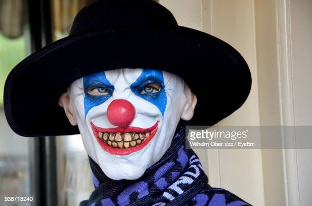 close-up portrait of mature man with clown make-up - scary clown makeup stock photos and pictures