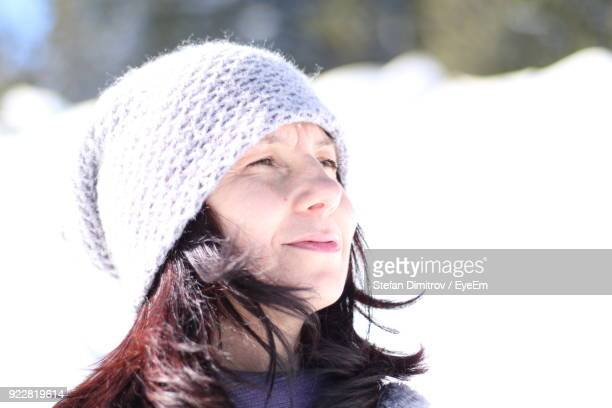 Close-Up Portrait Of Mature Woman In Snow