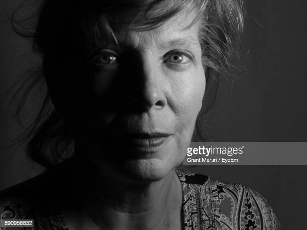close-up portrait of mature woman - black and white face stock photos and pictures