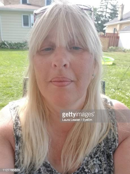 close-up portrait of mature woman sitting outdoors - human mouth stock pictures, royalty-free photos & images