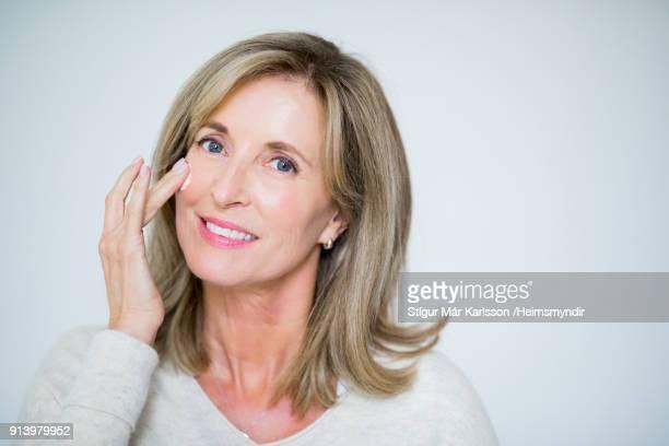 Close-up portrait of mature woman smiling