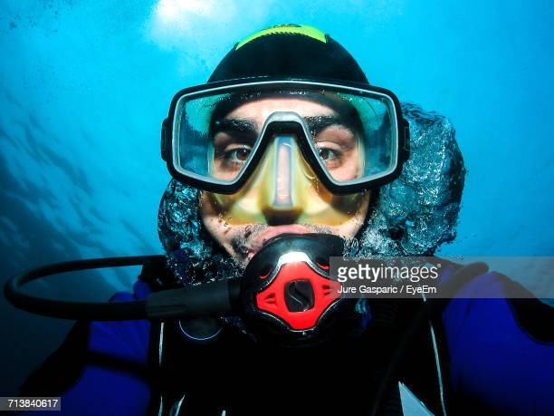 Close-Up Portrait Of Mid Adult Man In Scuba Mask
