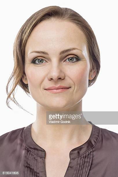 Close-up portrait of mid adult woman over white background