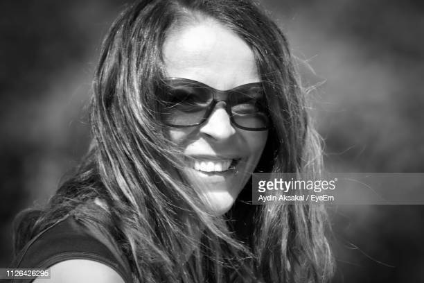 Close-Up Portrait Of Mid Adult Woman Wearing Sunglasses