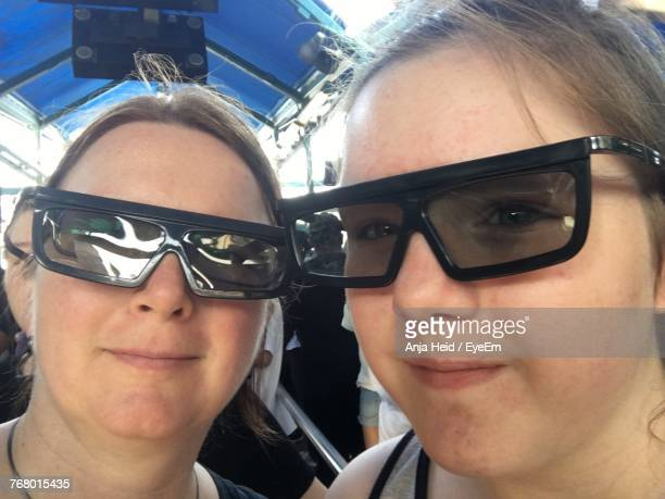 Close-Up Portrait Of Mother Ad Daughter Wearing 3-D Glasses