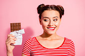 Close-up portrait of nice cute charming attractive winsome glamorous cheerful girl wearing striped t-shirt holding in hands looking favorite dessert life lifestyle advert isolated on pink background
