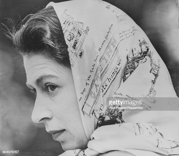 Closeup portrait of Queen Elizabeth II wearing a silk head scarf at Badminton Horse Trials in Gloucestershire England April 19th 1958