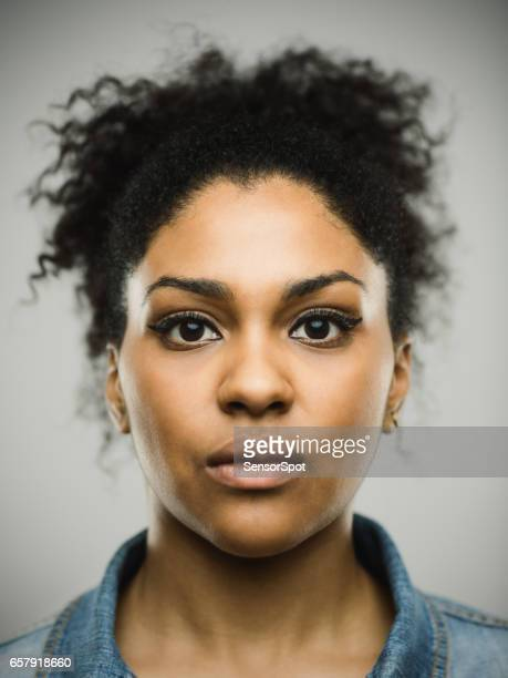 Close-up portrait of real young black woman