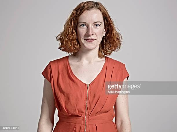 close-up portrait of red-headed woman smiling. - red dress stock pictures, royalty-free photos & images