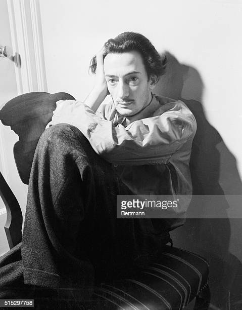 Closeup portrait of Salvador Dali He is shown here resting his head on the back of a chair