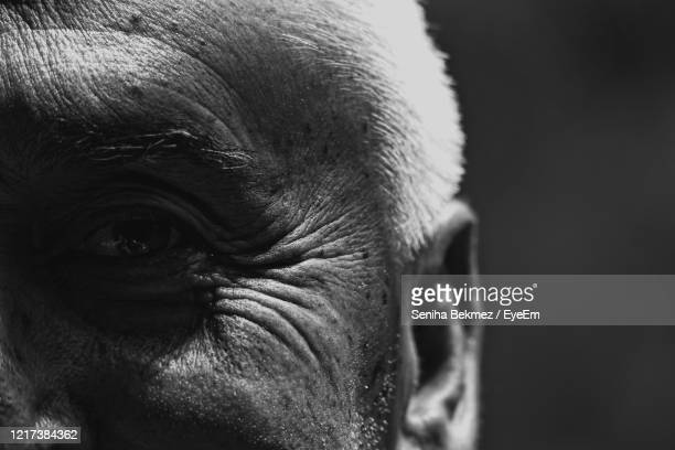 close-up portrait of senior man eye - differential focus stock pictures, royalty-free photos & images