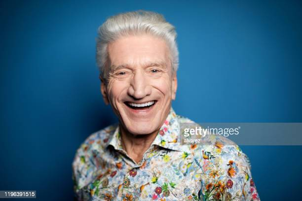 close-up portrait of senior man laughing - ecstatic stock pictures, royalty-free photos & images