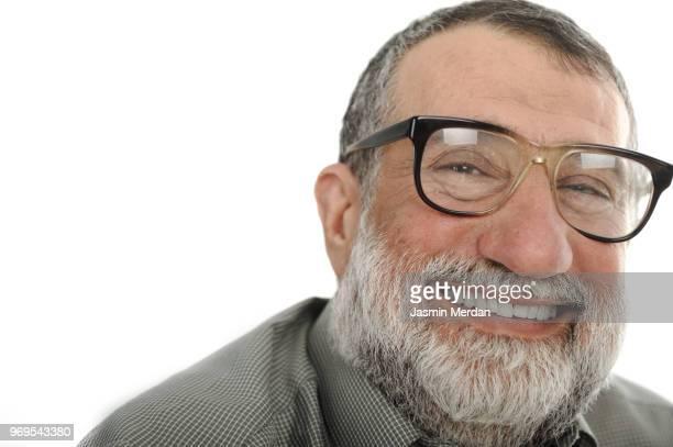 close-up portrait of senior man smiling - jordanian workforce stock pictures, royalty-free photos & images