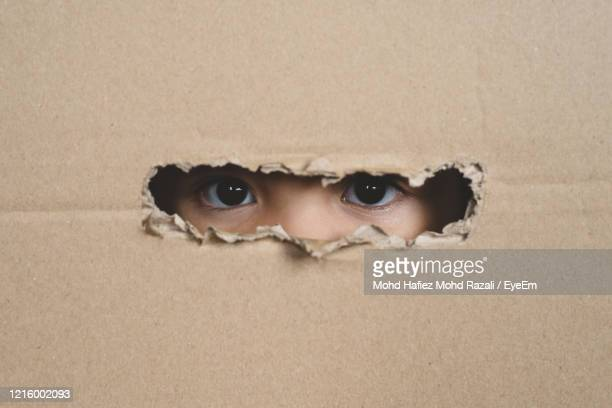 close-up portrait of serious young man with hole - trafficking stock pictures, royalty-free photos & images
