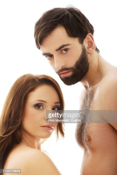close-up portrait of shirtless couple against white background - female hairy chest stock pictures, royalty-free photos & images