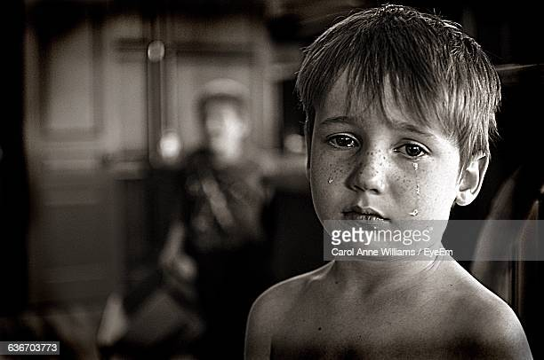 Close-Up Portrait Of Shirtless Crying Boy