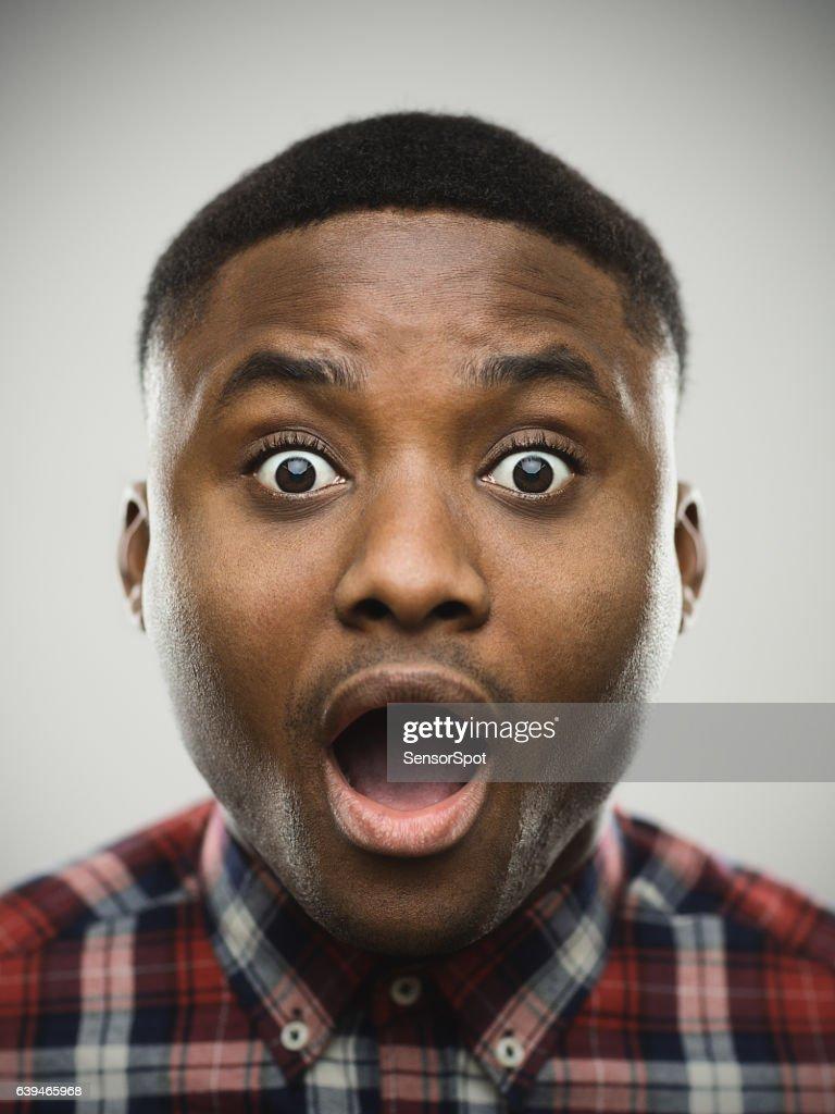 Close-up portrait of shocked man : Stock Photo