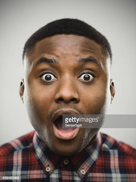 close-up portrait of shocked man - mouth open stock pictures, royalty-free photos & images