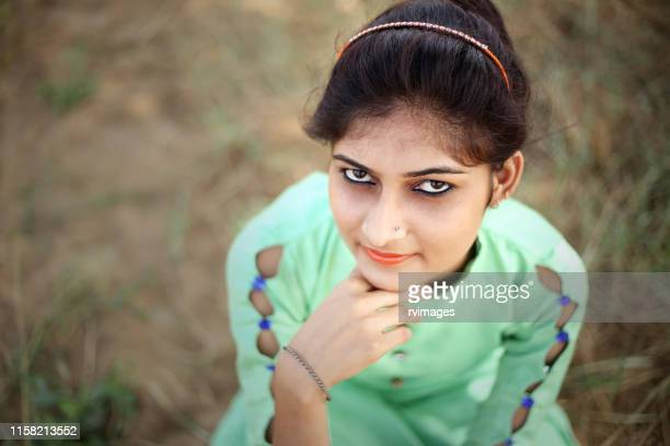 close-up portrait of sitting girl - salwar kameez stock pictures, royalty-free photos & images