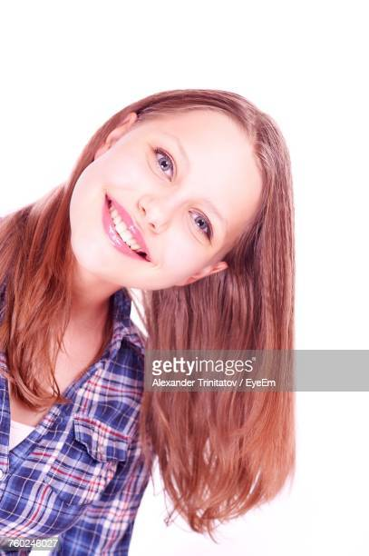 Close-Up Portrait Of Smiling Beautiful Woman Against White Background