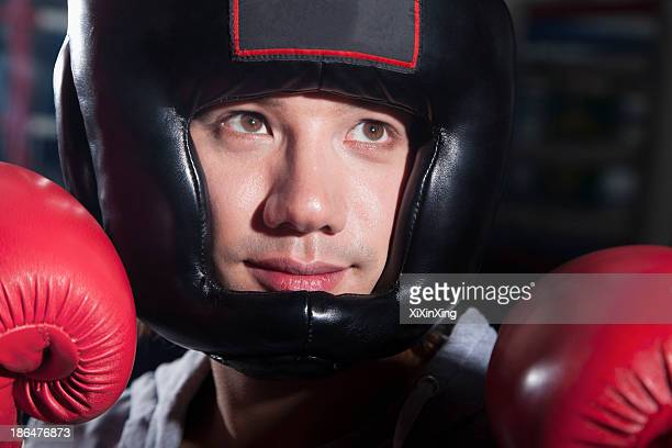 Close-up portrait of smiling boxer in headgear