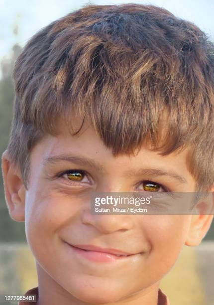 close-up portrait of smiling boy - pakistan stock pictures, royalty-free photos & images