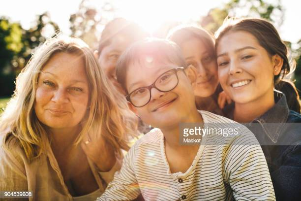 close-up portrait of smiling family at park - intellectually disabled stock pictures, royalty-free photos & images