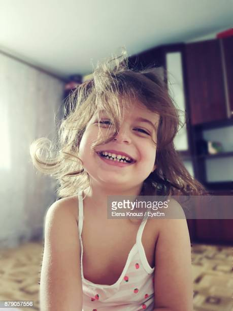 close-up portrait of smiling girl at home - elena knouzi stock pictures, royalty-free photos & images