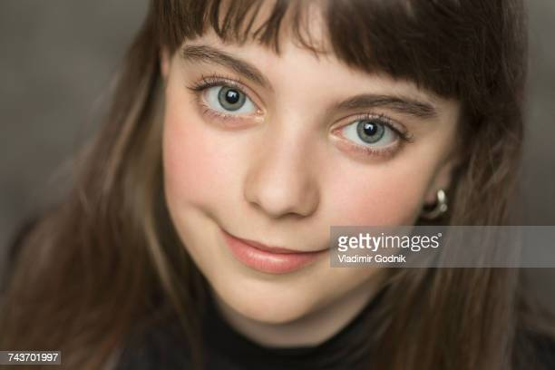 close-up portrait of smiling girl with brown hair - grey eyes stock pictures, royalty-free photos & images