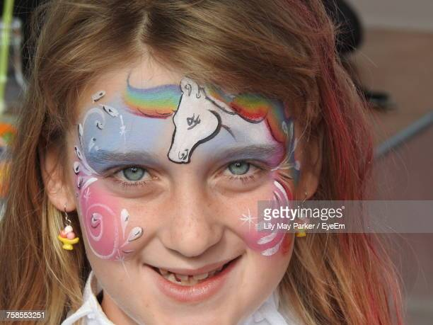 Close-Up Portrait Of Smiling Girl With Face Paint