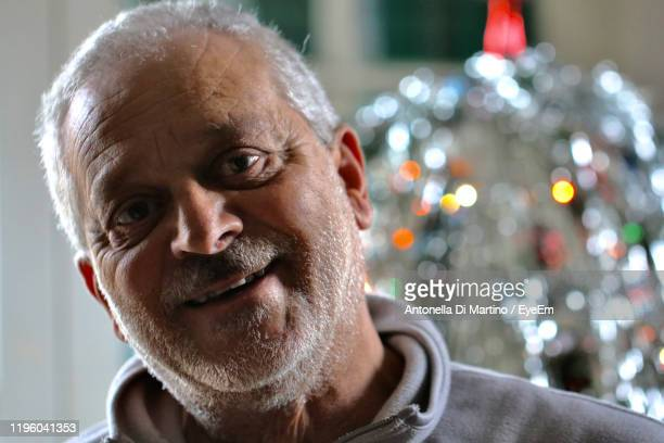 close-up portrait of smiling man at home - antonella di martino foto e immagini stock