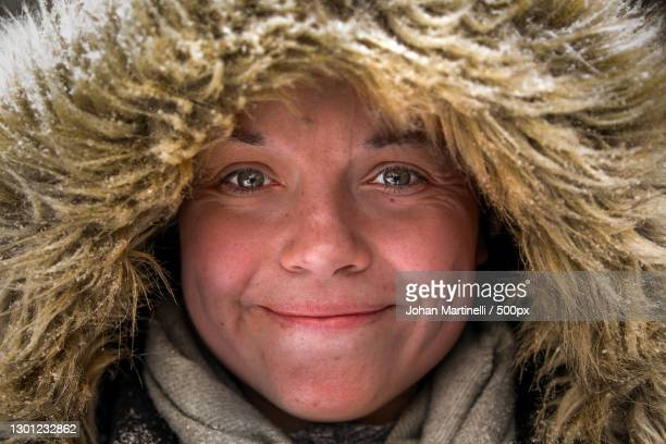 close-up portrait of smiling woman wearing fur coat,sverige,sweden - martinelli stock pictures, royalty-free photos & images