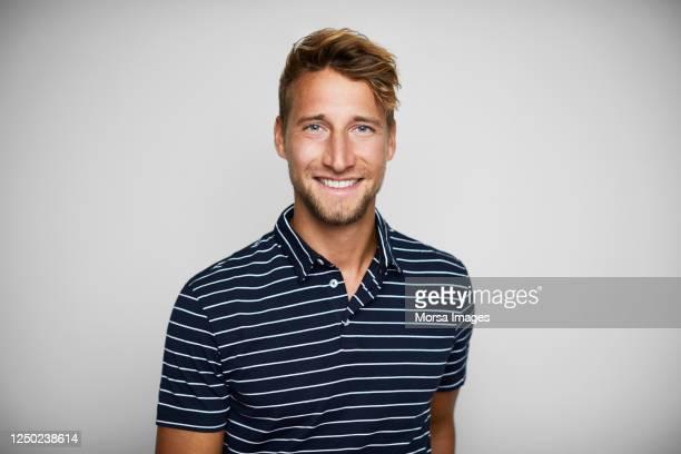 close-up portrait of smiling young man. - porträt stock-fotos und bilder