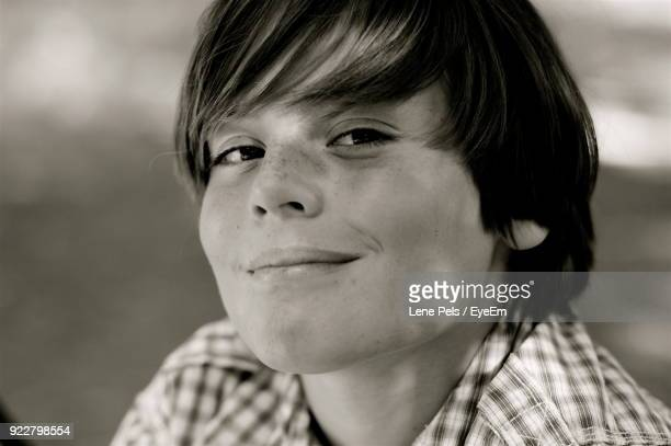 close-up portrait of smiling young man - lene pels stockfoto's en -beelden