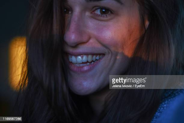 close-up portrait of smiling young woman - jelena ivkovic stock pictures, royalty-free photos & images