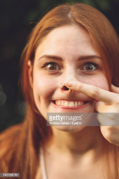 close-up portrait of smiling young woman - long nose stock photos and pictures