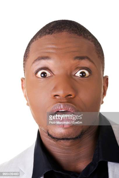 Close-Up Portrait Of Surprised Businessman Against White Background