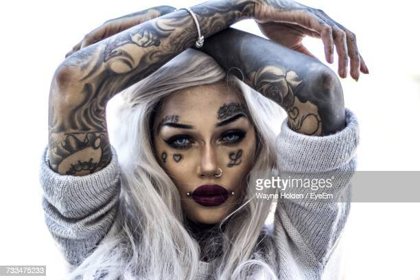 close-up portrait of tattooed fashion model against white background - tattoo designs hearts stock pictures, royalty-free photos & images