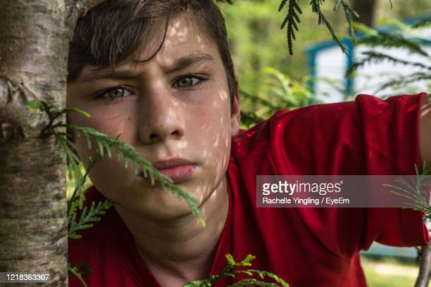 close-up portrait of teenage boy - reality fernsehen stock pictures, royalty-free photos & images