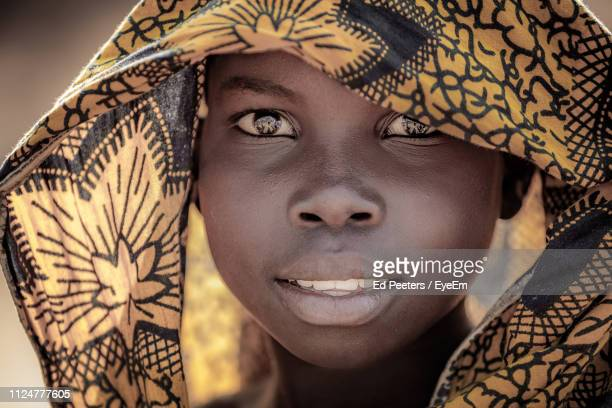 close-up portrait of teenage girl wearing headscarf - malawi stock pictures, royalty-free photos & images
