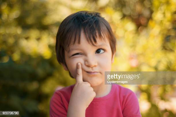 close-up portrait of thinking little girl looking away with thoughtful facial expression - gesturing stock pictures, royalty-free photos & images