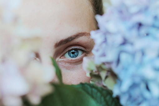 Close-Up Portrait Of Woman By Flowers - gettyimageskorea