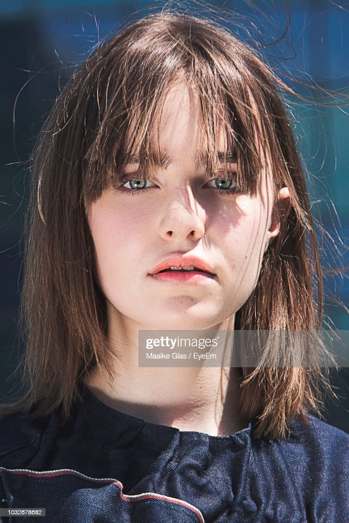 Close-Up Portrait Of Woman In City During Sunny Day : Foto de stock