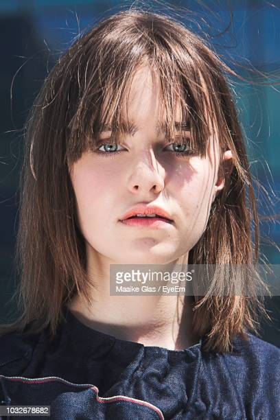 close-up portrait of woman in city during sunny day - fringe stock pictures, royalty-free photos & images