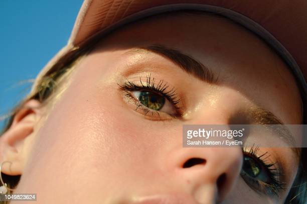 close-up portrait of woman in sunny day - eye make up stock pictures, royalty-free photos & images