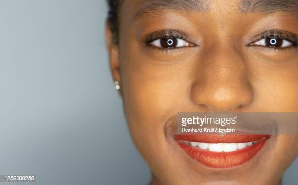 close-up portrait of woman - chin stock pictures, royalty-free photos & images